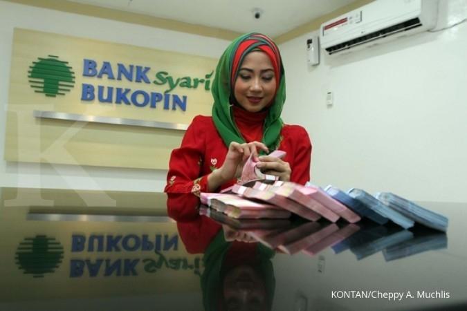 Akuisisi bank lokal belum padam