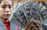 On the spot market, rupiah weakened to Rp 14,733 per US dollar