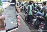 Ministry to survey public response to new online 'ojek' fares