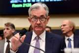 Fed cuts rates to blunt coronavirus impact, markets drop