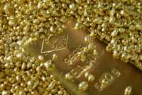 Gold inches lower as investors seek clarity on virus severity