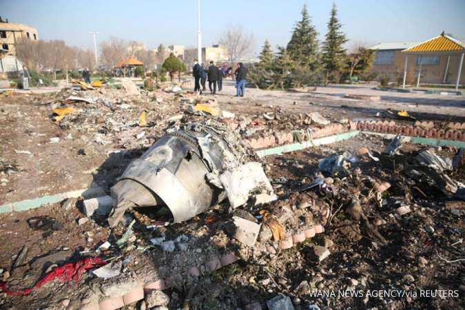 Iran probe says Ukrainian jet was on fire before crash