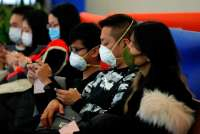 WHO says emergency in China, as virus death toll rises to 18