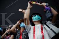 Expert sees coronavirus over by April in China, WHO still alarmed