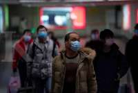 China says coronavirus curbs start to work; 70 more cases on cruise ship