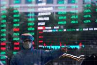 Asian shares struggle for traction as Fed cut fails to lift confidence