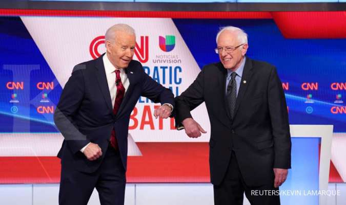 Democratic U.S. presidential candidates former Vice President Joe Biden and Senator Bernie Sanders do an elbow bump in place of a handshake as they greet other before the start of the 11th Democratic candidates debate of the 2020 U.S. presidential campaig