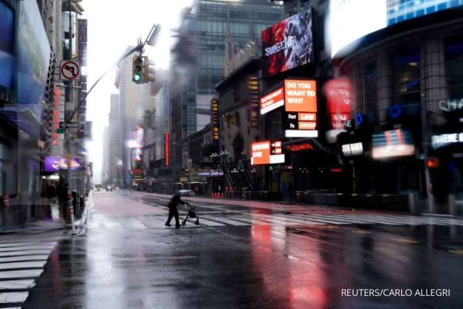 A person with a walker crosses 42nd Street in a mostly deserted Times Square following the outbreak of Coronavirus disease (COVID-19), in the Manhattan borough of New York City, New York, U.S., March 23, 2020. REUTERS/Carlo Allegri TPX IMAGES OF THE DAY